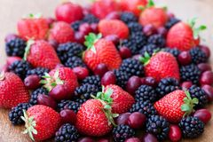 Berries, summer fruit on wooden table Stock Photography