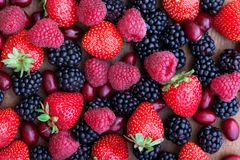 Berries, summer fruit on wooden table Stock Images
