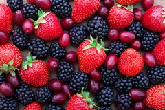 Berries, summer fruit on wooden table royalty free stock images
