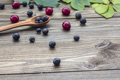 Berries on the table. Ripe berries on a wooden table in the early morning Royalty Free Stock Photos