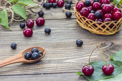 Berries on the table. Ripe berries on a wooden table in the early morning Stock Image