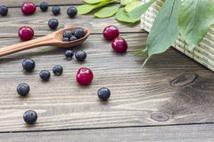 Berries on the table. Ripe berries on a wooden table in the early morning Stock Photo