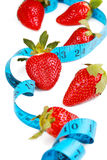 Berries with tape measure. Health concept. Stock Photos
