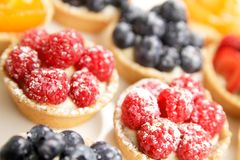 Berries tarts display Royalty Free Stock Photos