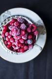Berries in teacup. Frozen wild berries in teacup Royalty Free Stock Images