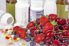 Berries, vitamins and nutritional supplements Stock Image