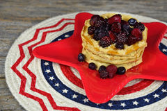 Berries and waffles on red star plate Royalty Free Stock Images