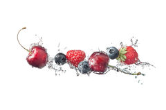 Berries with water splashes isolated on white background Royalty Free Stock Photo