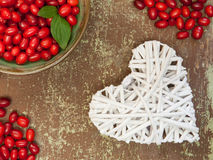 Berries and white colored heart shape Royalty Free Stock Photos