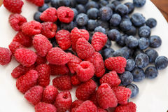 Berries on white plate Royalty Free Stock Images