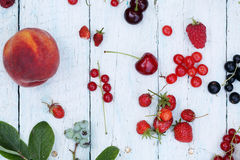 Berries on white wooden background Stock Photography