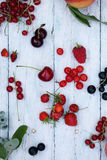 Berries on white wooden background Royalty Free Stock Photography