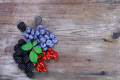 Berries on wooden background with copyspace Royalty Free Stock Images
