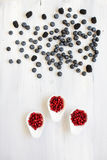 Berries on Wooden Background flat lay. Royalty Free Stock Images