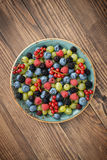 Berries on wooden background Stock Photo