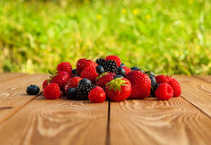 Berries on Wooden Background. Stock Photo