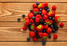 Berries on Wooden Background. Stock Images