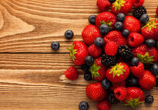 Berries on Wooden Background. Royalty Free Stock Images