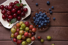 Berries on Wooden Background. Organic food Stock Photo