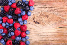 Berries on Wooden Background. Raspberries, Blueberry Royalty Free Stock Images