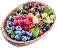 Berries in the wooden bowl on a white. Stock Photo