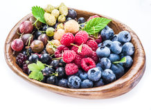 Berries in the wooden bowl on a white. Royalty Free Stock Images