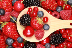 Berries on a wooden spoon Stock Photography