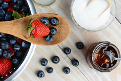 Berries Wooden Spoon and Colander Royalty Free Stock Photos