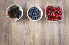 Berries on a wooden table. In natural light Royalty Free Stock Photos