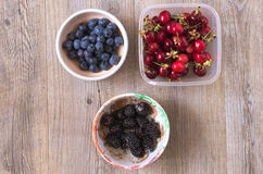 Berries on a wooden table. In natural light Stock Photography