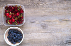 Berries on a wooden table. In natural light Stock Images