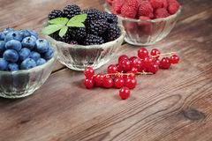 Berries on a wooden table Royalty Free Stock Image