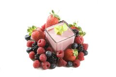 Berries yoghurt. Mixed berries and berry yoghurt royalty free stock photos