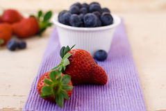 Berry. Spring sweet bilberry and strawberry Stock Photos