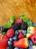 Berry assortment - raspberries, blackberries, strawberries, blueberry. On a wooden background Stock Photo
