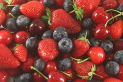 Berry Assortment, Strawberry, Bilberry and Cherry Royalty Free Stock Images