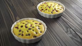 Berry biscuit mini tarts in a baking dish. Tasty dessert with currants. Dark wooden background stock video footage
