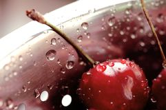 Berry black cherry with water drops in a colander Stock Photo