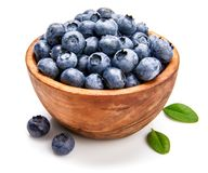 Berry blueberry in wooden dish stock photography
