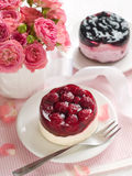 Berry Cake And Pink Roses Stock Photos