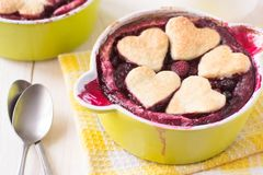 Berry cake with hearts. In baking dish royalty free stock photo