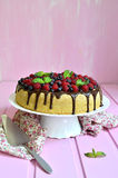 Berry cake with sour cream and chocolate glaze. Royalty Free Stock Photography