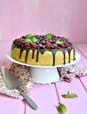 Berry cake with sour cream and chocolate glaze. Royalty Free Stock Photos