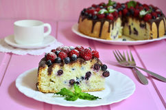 Berry cake with sour cream and chocolate glaze. Royalty Free Stock Photo