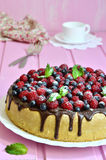 Berry cake with sour cream and chocolate glaze. Stock Photo