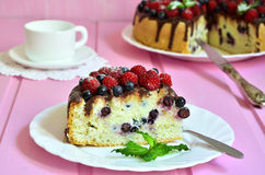 Berry cake with sour cream and chocolate glaze. Royalty Free Stock Image