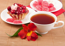 Berry cake with tea and jelly Stock Photo