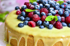Berry cake with white chocolate glaze. Royalty Free Stock Photography