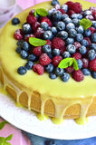 Berry cake with white chocolate glaze. Royalty Free Stock Photo