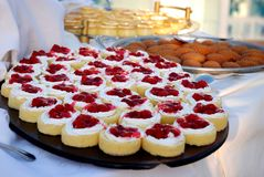 Berry cakes... Selection of fruit cakes on buffet in the hotel Stock Image